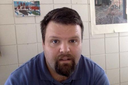 Headshot of man looking at camera