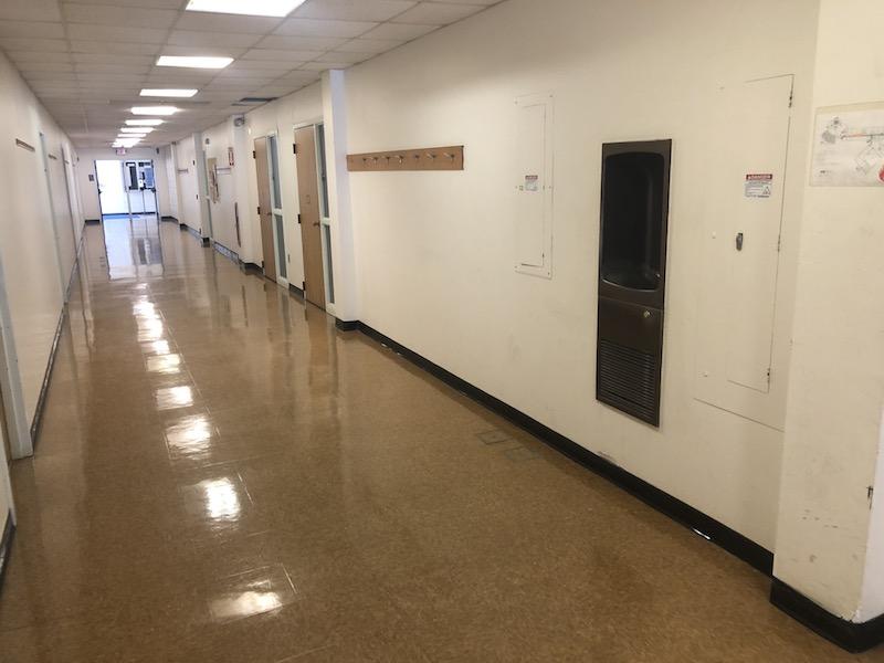 Play of light along floor of empty corridor